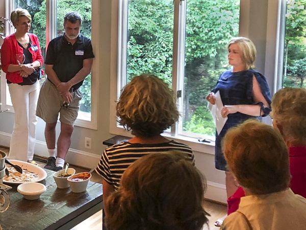 Christly Clark speaks at 206 fundraiser.